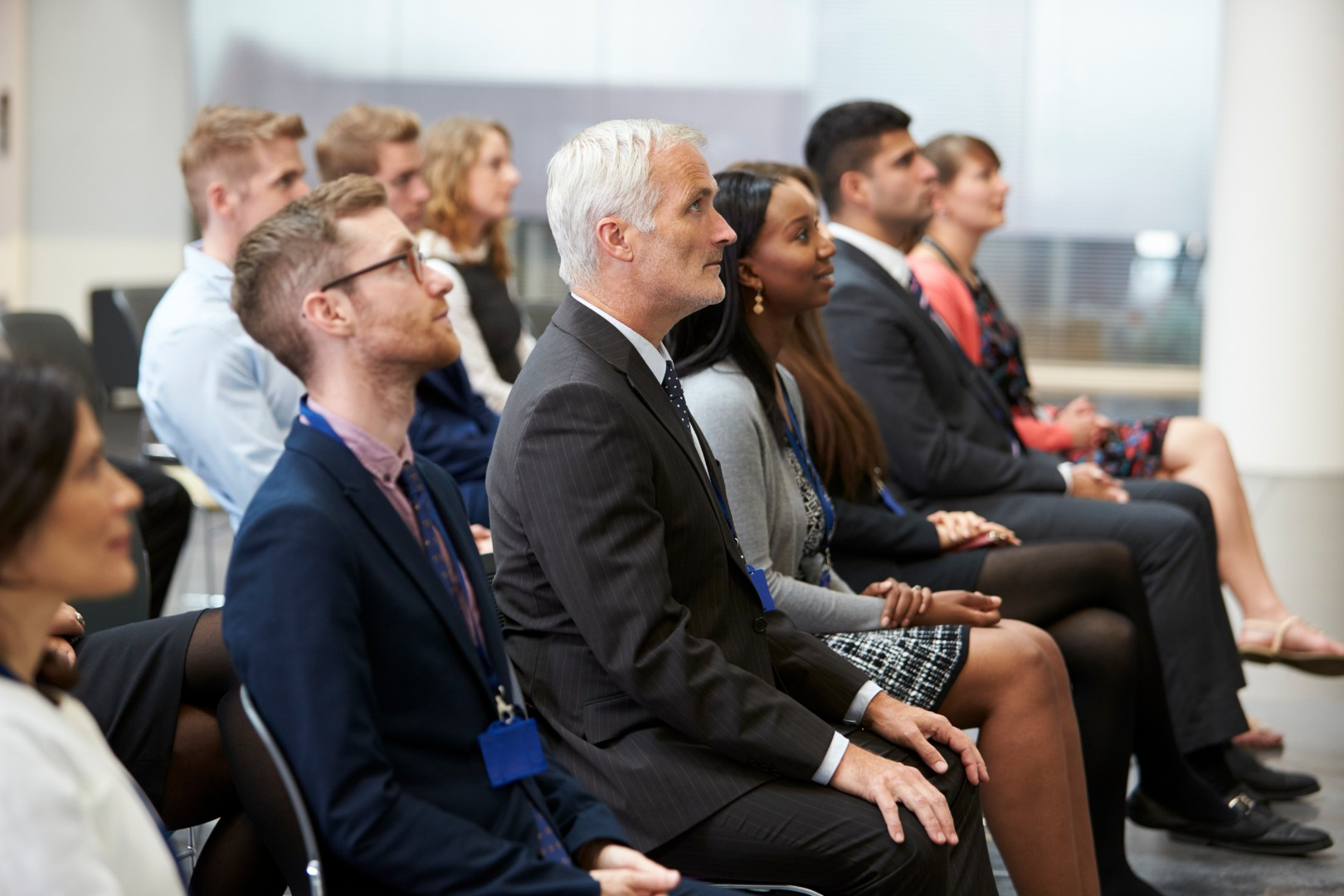 audience-listening-to-speaker-at-conference